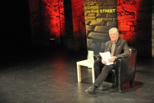 Pat Kenny reading from a piece of Spanish literature